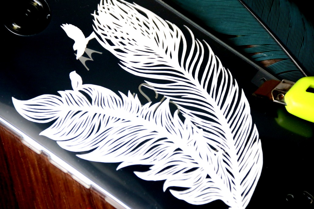 Paper cutting bird feather
